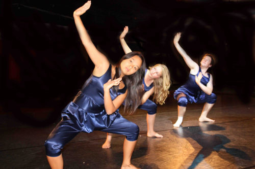 3 female students dancing in Lift Theatre