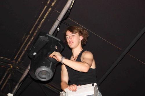 Student adjusting light in Lift Theatre