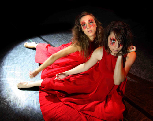 2 students in red dresses in Lift Theatre