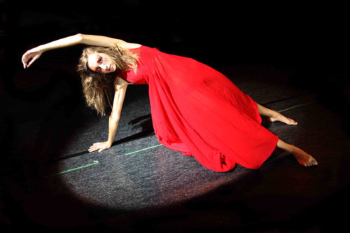 Student in red dress in Lift Theatre