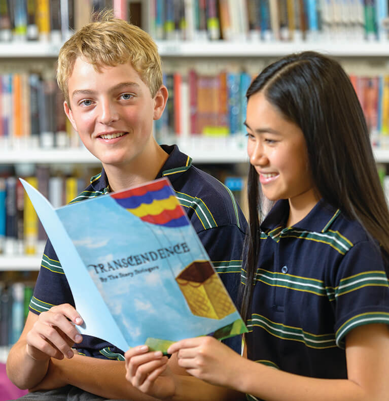 2 students in Brighton Secondary School Library