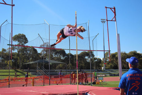 School Sports student pole vaulting