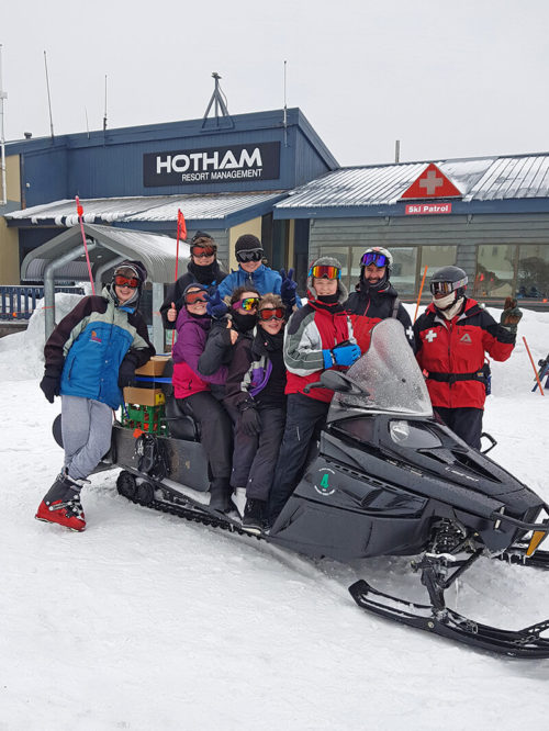 Students on Ski Trip riding snow mobile